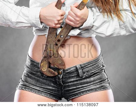 Closeup Of Sexy Woman With Monkey Wrench. Feminism