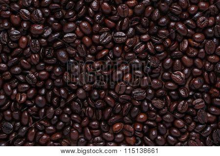 Roasted Coffee Beans On Wood.