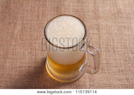 Glasses Of Beer On Sackcloth Background.