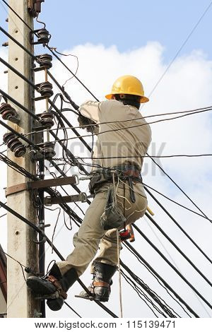 Electricians Working On The Electricity Pole.