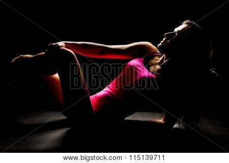 Woman In Pink Tank And Shorts Sit Back Legs Crossed Hand On Knee Highlighted