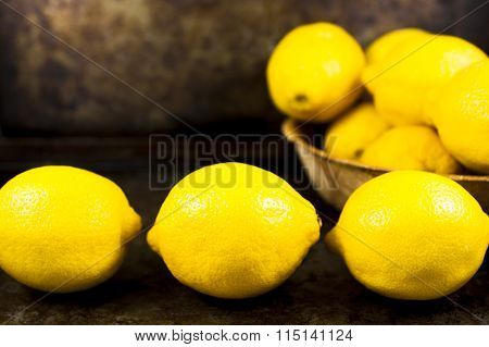 Whole Lemons Against A Rustic Backdrop