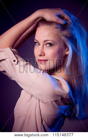Beauty portret of caucasian woman bathed with colorful light