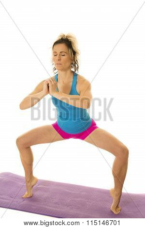 Woman Blue Tank And Pink Shorts Fitness Squat On Toes Eyes Close
