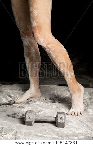 Woman Legs Covered In White Powder One Heel Up