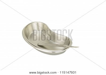 Stainless Steel Blade In Kidney-shaped Bowl Isolated