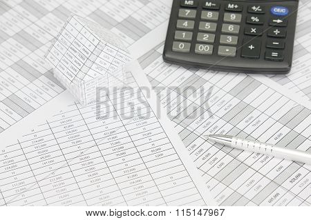 Silver Pen With House And Calculator On Finance Account