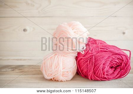 Threads For Knitting With Spokes On Wooden Table