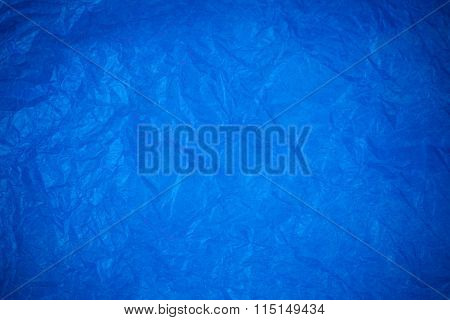 Blue Crumpled Paper Surface Background.