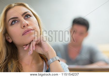 Thoughtful female student during class at the lecture hall