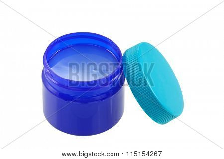A small blue green jar full of  mentholated topical ointment isolated on white