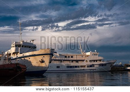 two old white ship in the dock