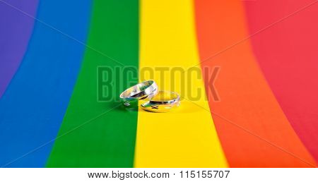 two rings on the background of rainbow flag