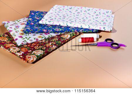 variety of colored fabrics.  Needlework