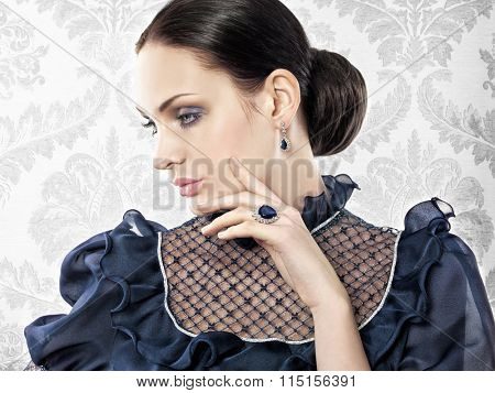 Portrait of elegant beautiful woman with jewellery