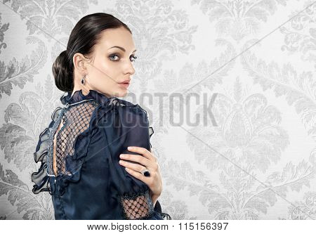 Portrait of elegant beautiful woman on light background. Space for text.