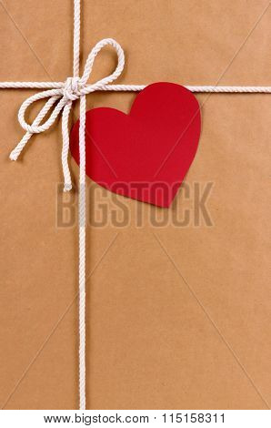 Valentine Gift With Gift Tag, Brown Paper Package Parcel Background, Copy Space, Vertical
