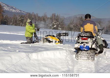Two Athletes Snowmobile