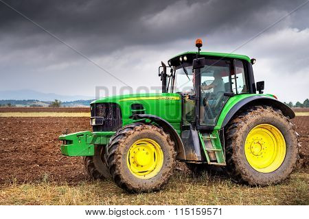 Karlovo, Bulgaria - August 22Th, 2015: Ploughing A Field With John Deere 6930 Tractor. John Deere 81