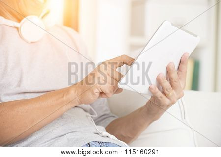 Asian Man Using Tablet Lifestyle Photo
