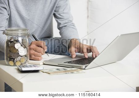 Man Doing Finance With Tablet Computer And Mobile Phone