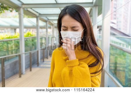 Asian woman coughing