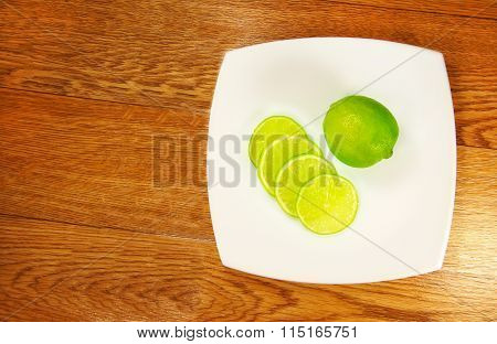 Fragrant Lime Wedges On The Saucer