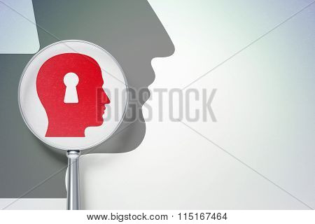 Advertising concept:  Head With Keyhole with optical glass on digital background