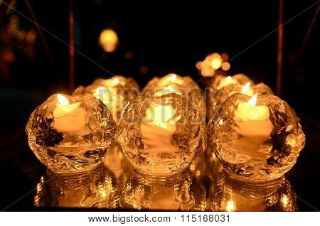 Candles in glass beads