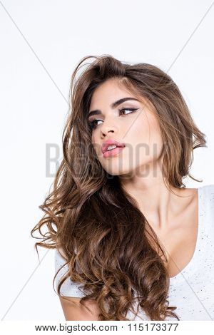 Portrait of a beautiful woman with long curly hair posing isolated on a white background