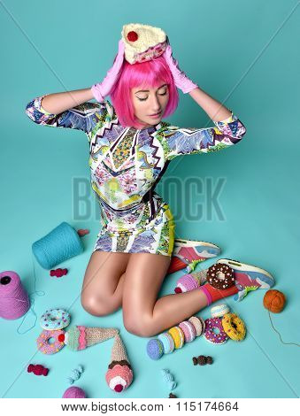 Woman In Hot Pink Party Wig Holding Fake Candy Cake On Head And Other Sweets Ice Cream Donuts