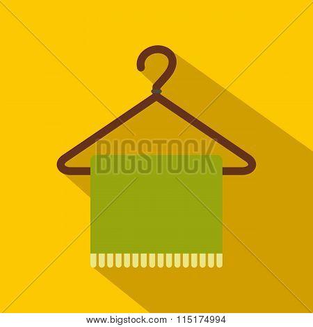 Green scarf on coat-hanger flat icon