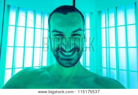 Man Taking Selfie In The Solarium With Stupid Expression