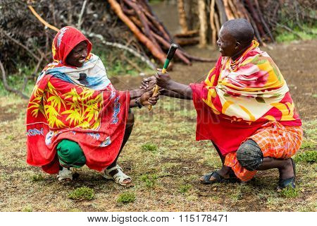 Massai men shaking hand concluding an agreement