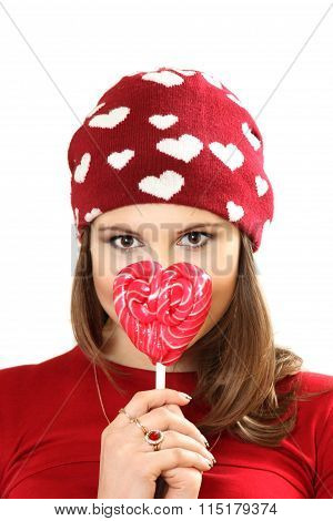 The Young Woman In A Red Cap With Hearts And With Sugar Candy Heart On A Stick