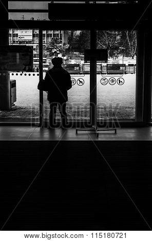 Man Waiting At A Window