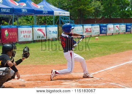 Zhongshan Panda Cup, Zhongshan, Guangdong - August 4:unknown Batter Hitting The Ball During A Match