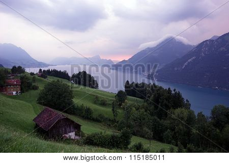 Farm Houses And Lake