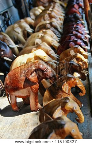 Row Of Carved Wooden Asian Elephants