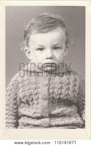 A small boy retro photo. Portrait photo was taken in photo studio circa 1972.