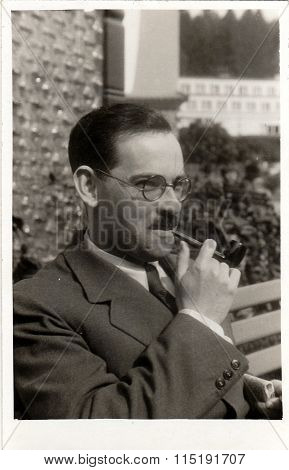 Vintage photo of man with pipe June 1938.