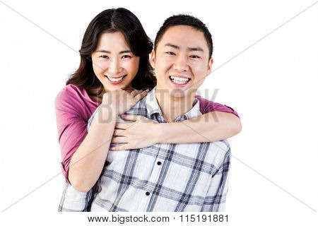 Smiling man gives girl a piggy back ride