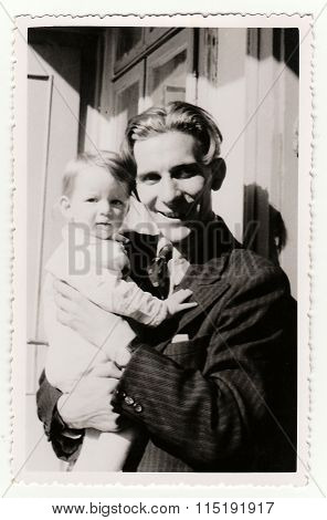 Vintage photos shows a small girl with her uncle, circa 1941