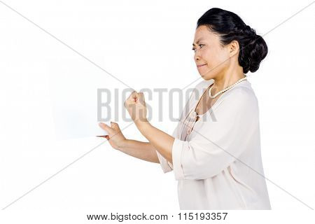 Angry woman shaking her fist on white background