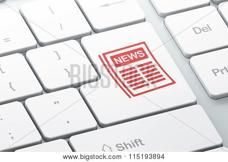 News concept: Newspaper on computer keyboard background