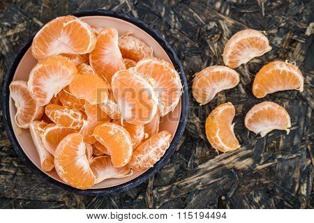 Ripe Juicy Mandarin Fruits In Enamel Plate On Blue Background