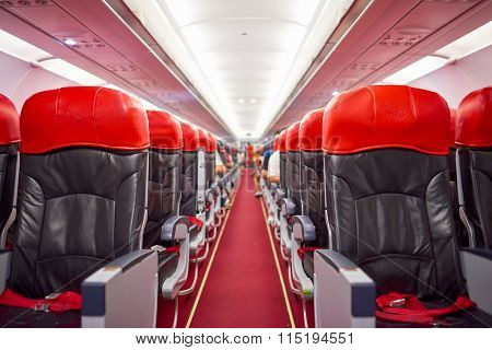 KUALA LUMPUR, MALAYSIA - MAY 02, 2014: interior of AirAsia Airbus A320-200. AirAsia Berhad is a Malaysian low-cost airline headquartered near Kuala Lumpur, Malaysia