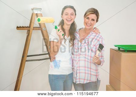 Mother and daughter redecorating a room together