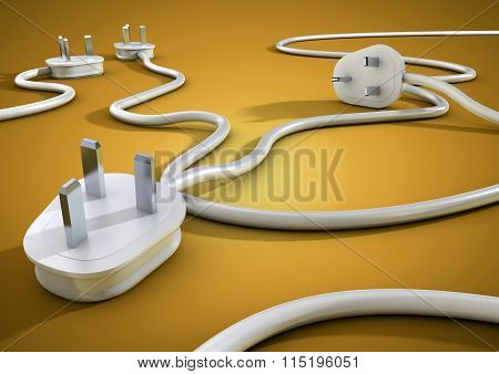 Power plugs lying on bright colored floor unplugged concept for energy and electricity conservation.