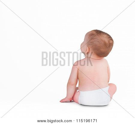 Baby Toddler Sitting Facing Backwards Isolated On A White Background
